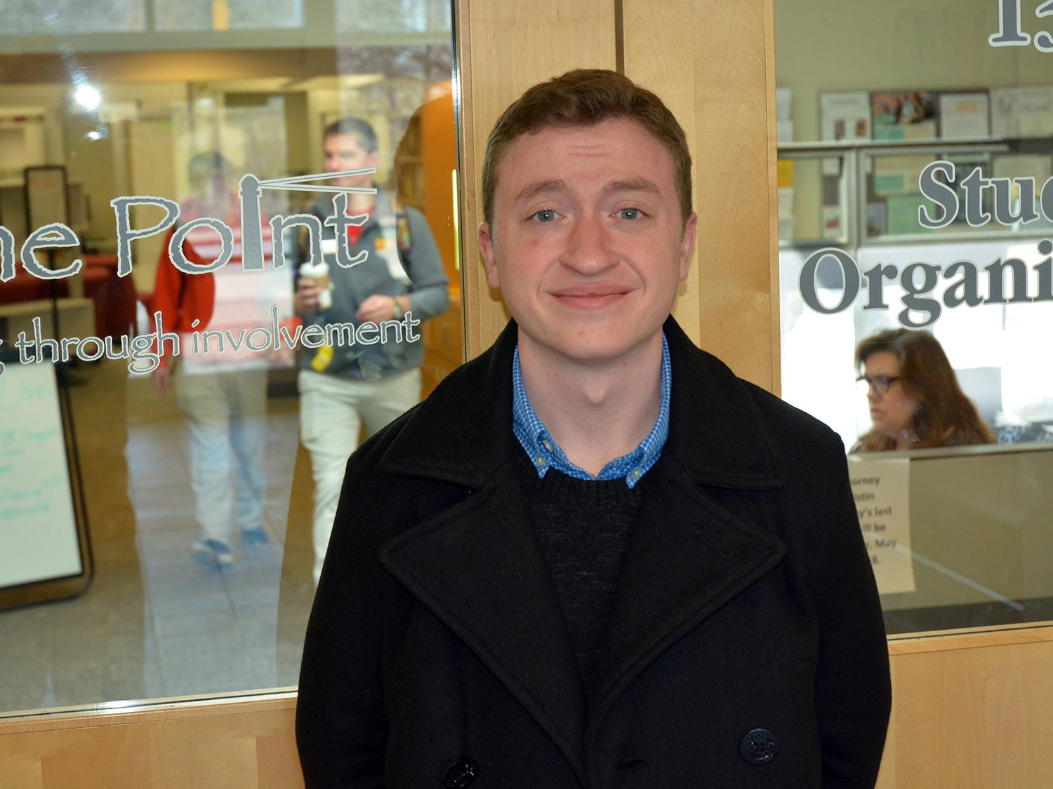 Conner Breese stands outside The Point, the student involvement hub