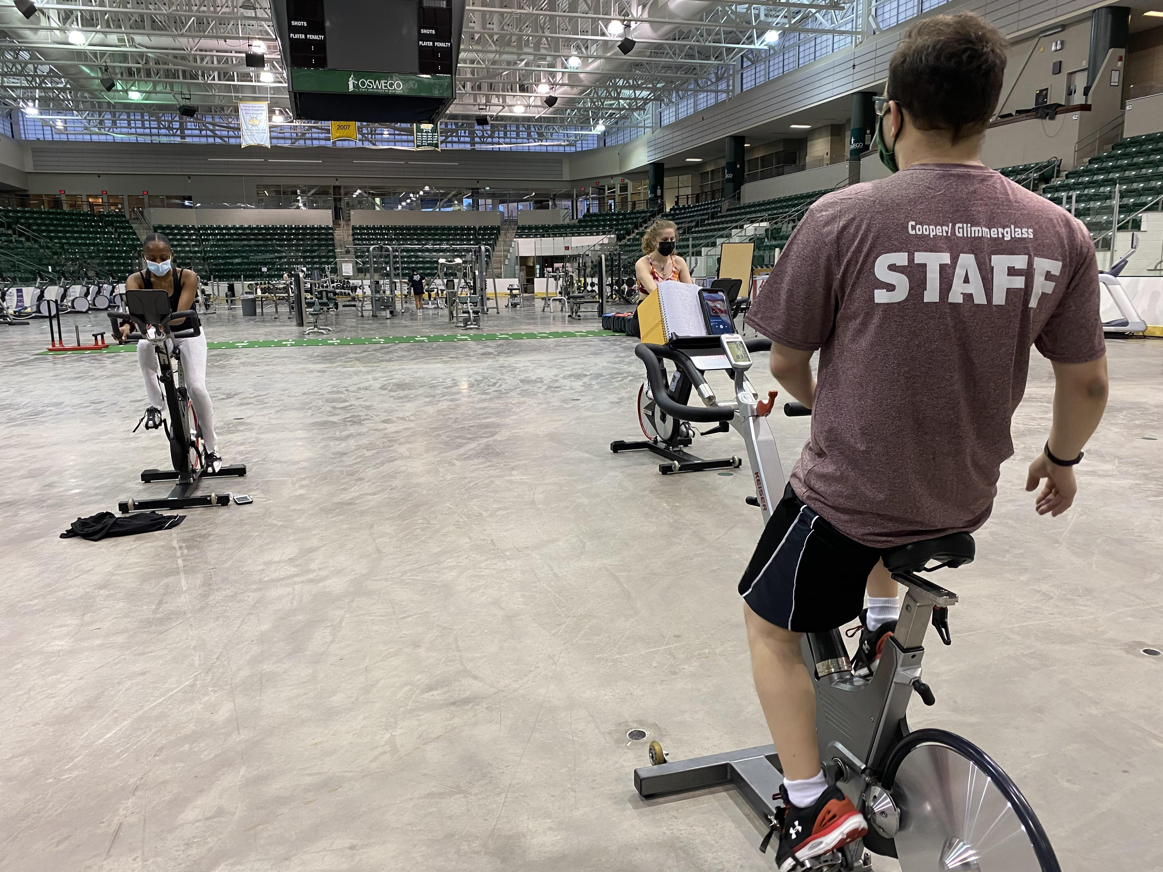 Students participate in an Indoor Cycling group workout