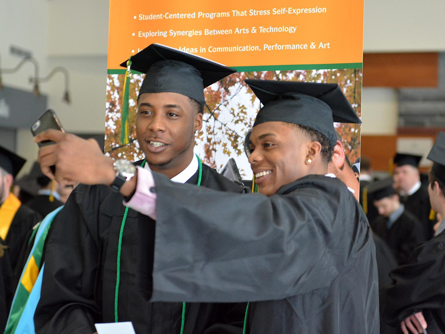 Two students take selfie before December Commencement
