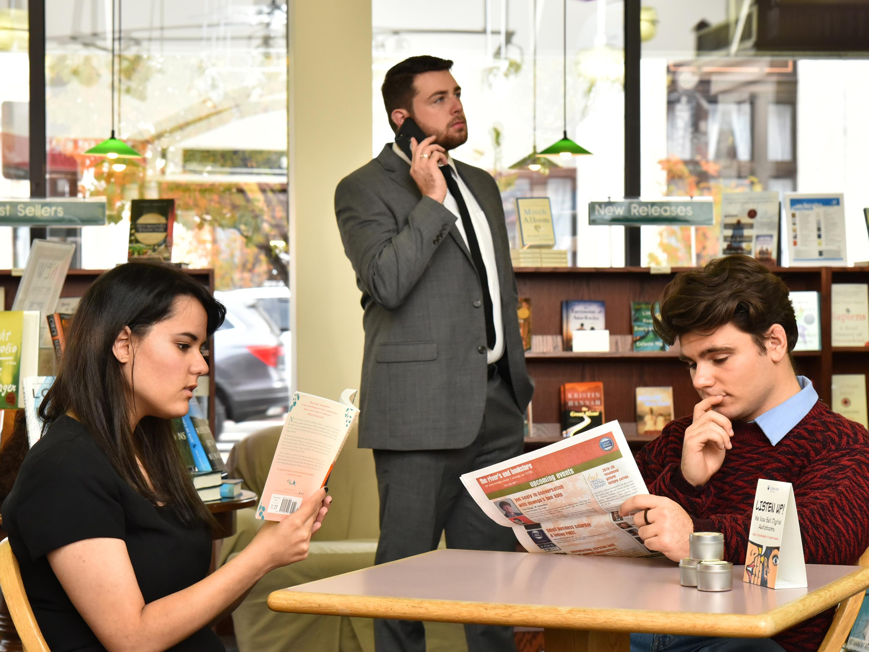 Production image for Dead Man's Cell Phone with actors in River's End Bookstore