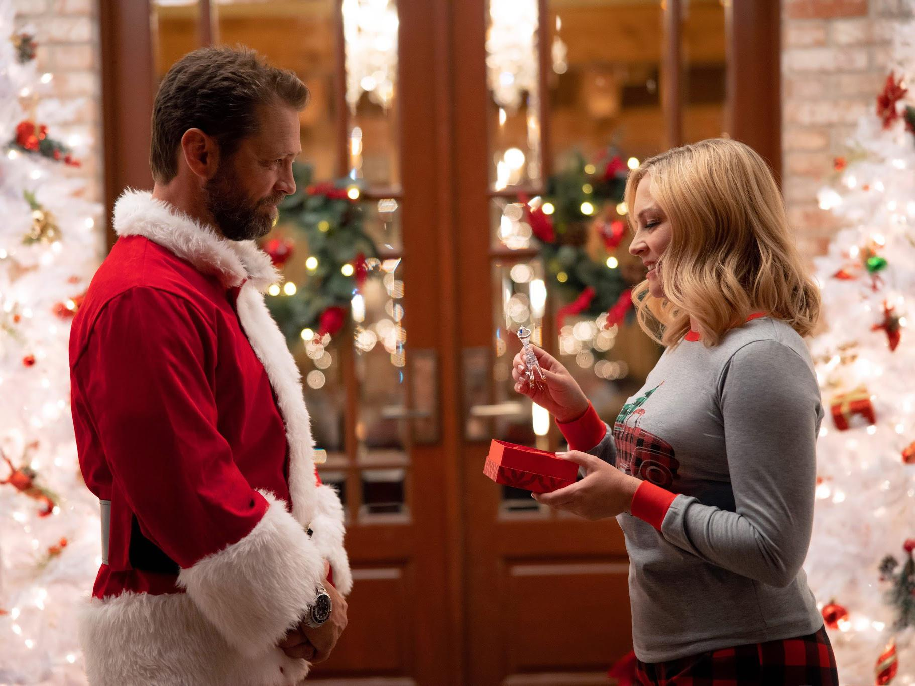 Jason Priestley and Melissa Joan Hart in promotional photo from Dear Christmas