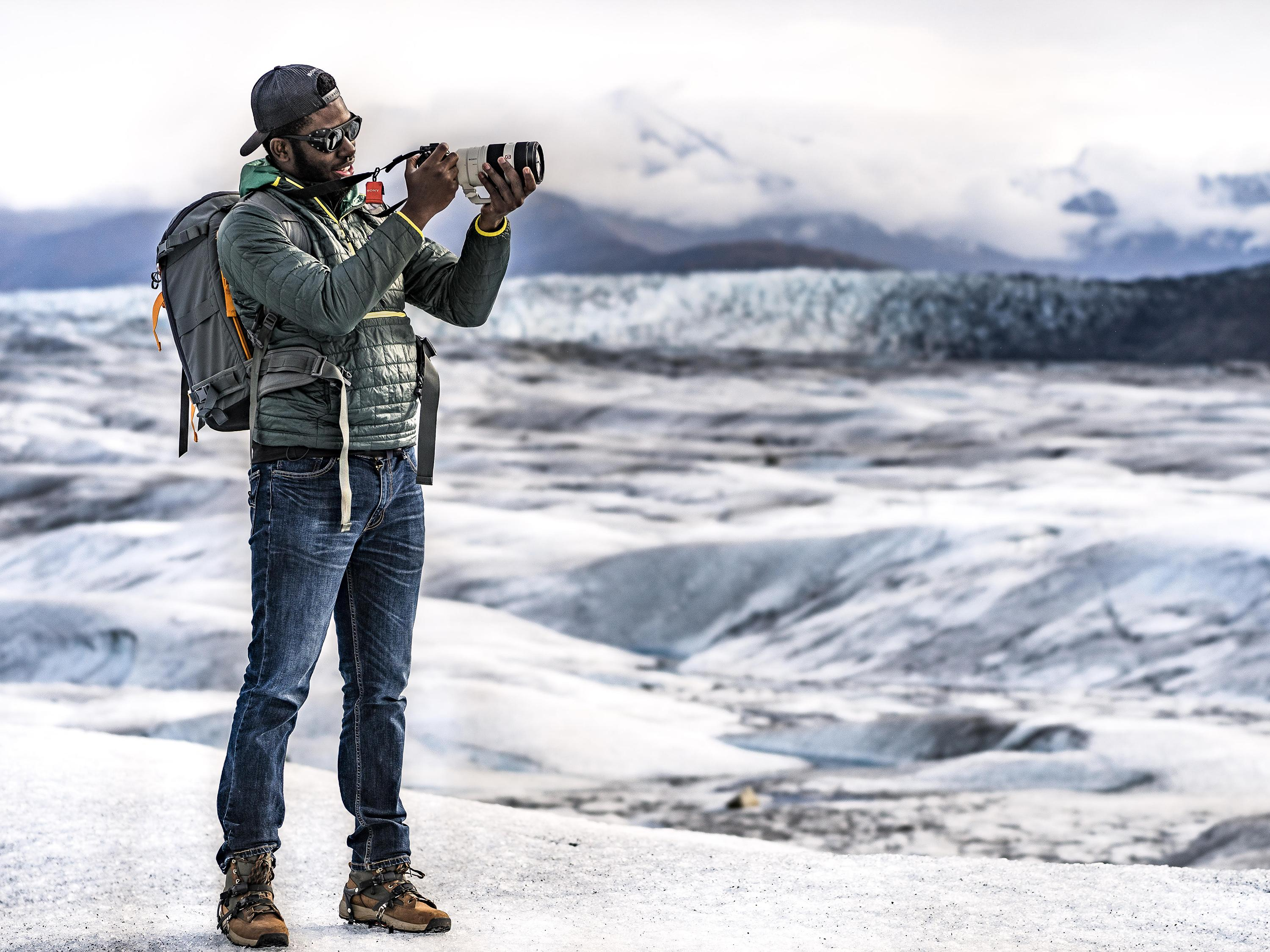 Mic-Anthony Hay takes photographs on a glacier in Alaska