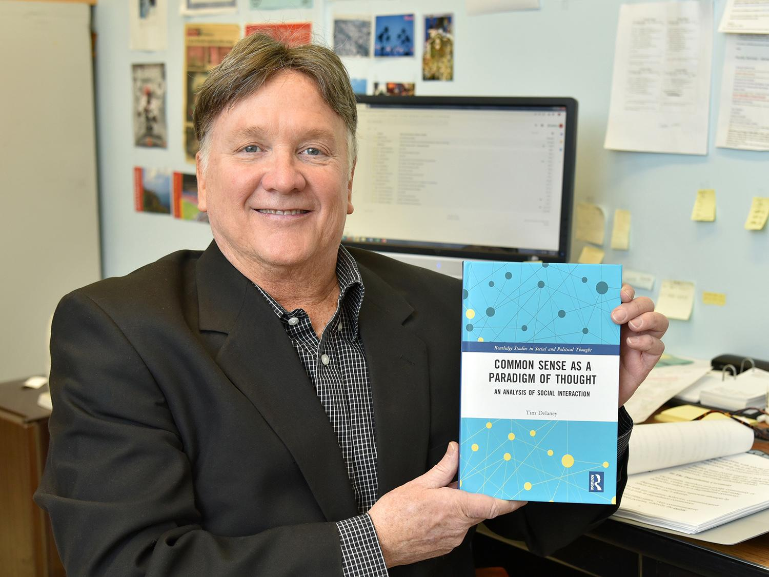 Tim Delaney with book, Common Sense as a Paradigm of Thought