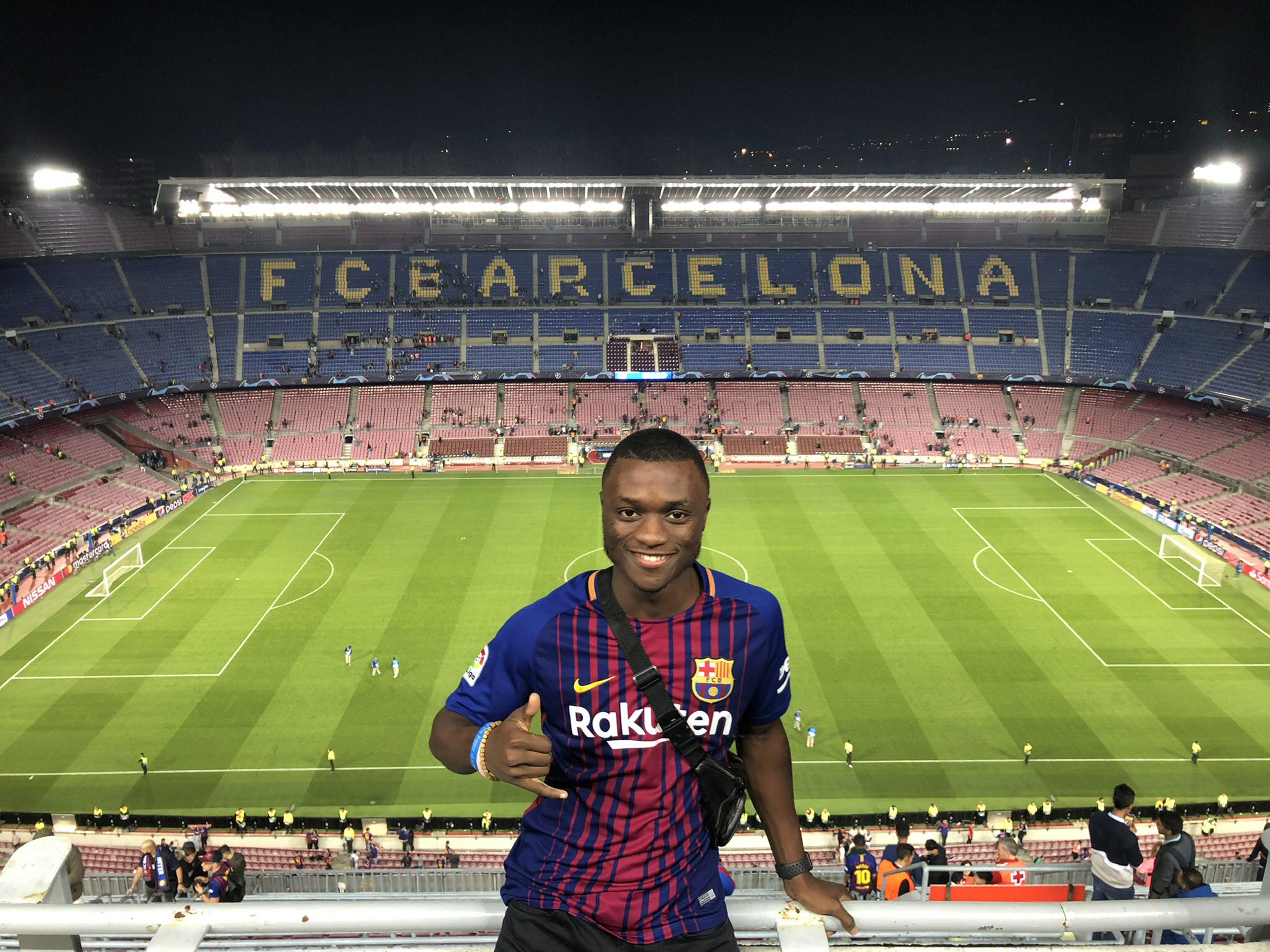 Nyezee Goe prepares to enjoy an FC Barcelona soccer match in Spain while on his study abroad exploration