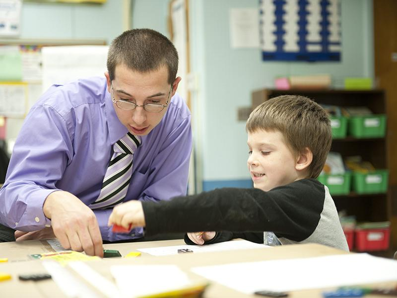 Oswego student teaching in a children's classroom with student