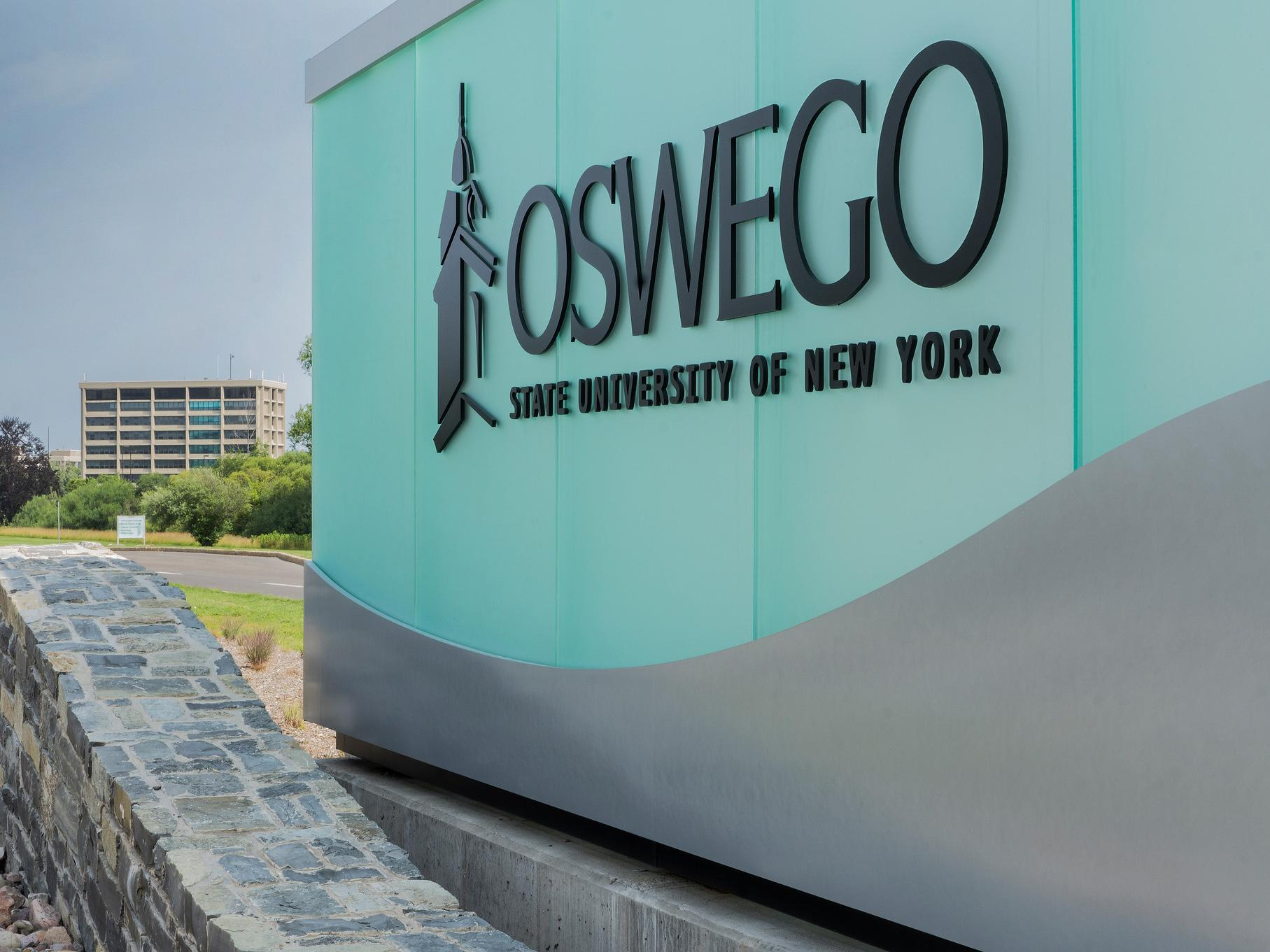 Oswego sign at college entrance