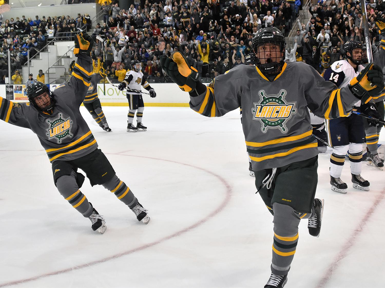 Laker men's hockey players celebrate a goal
