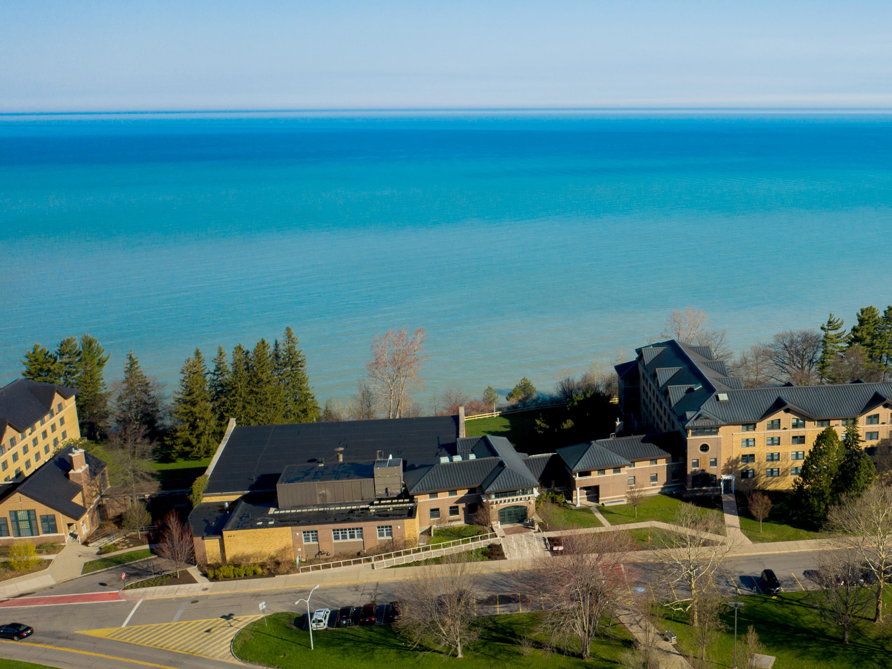 Aerial view of Lake Ontario and campus buildings