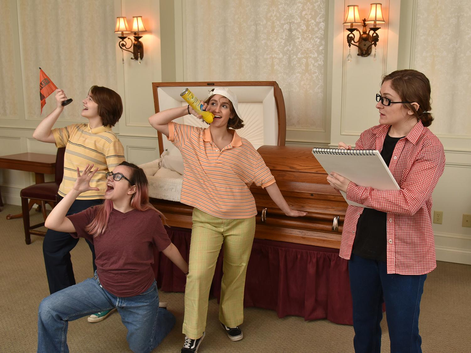Production image for Fun Home of actors portraying children playing in a funeral home