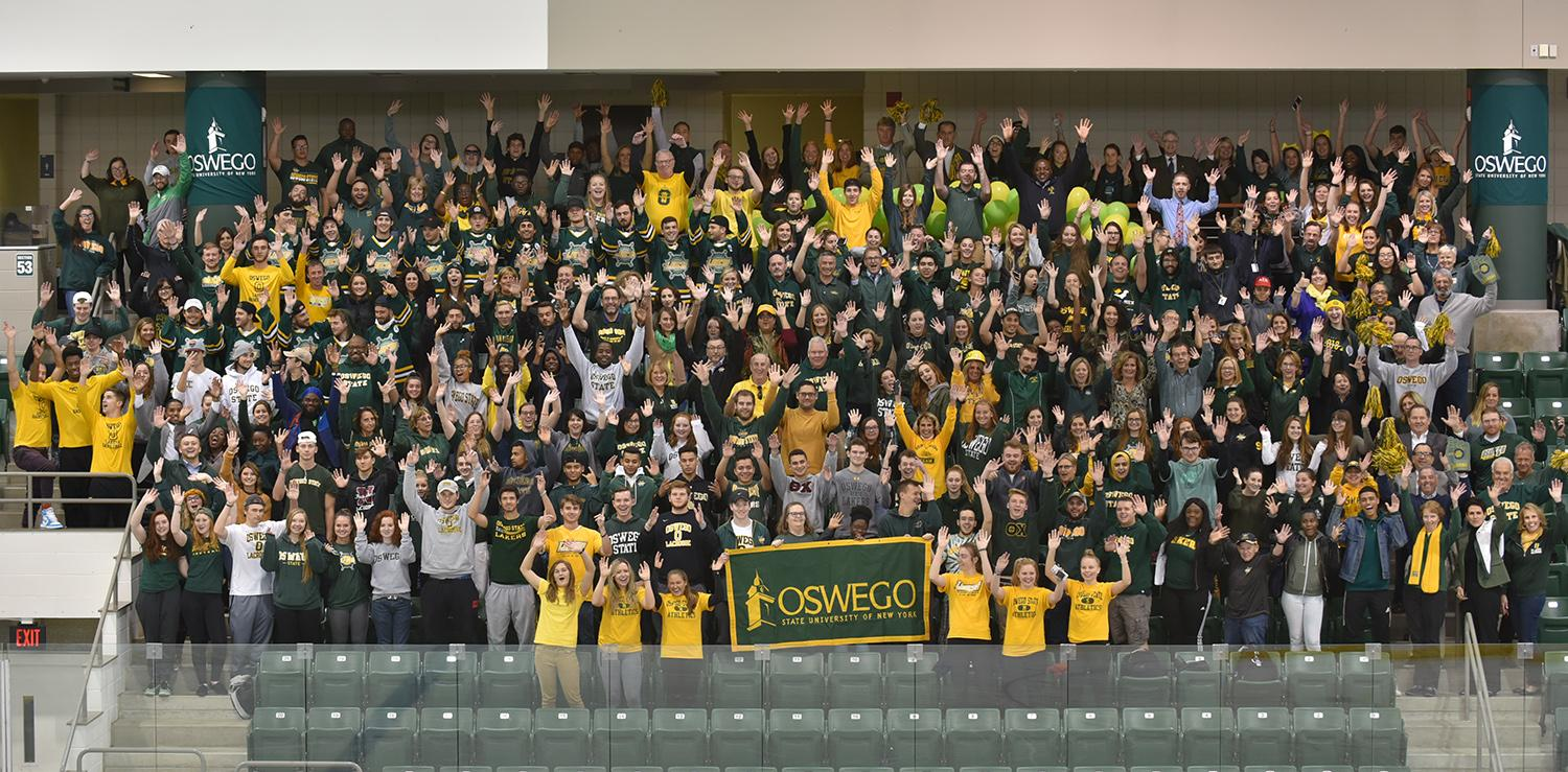 Many members of the campus community wearing green and gold