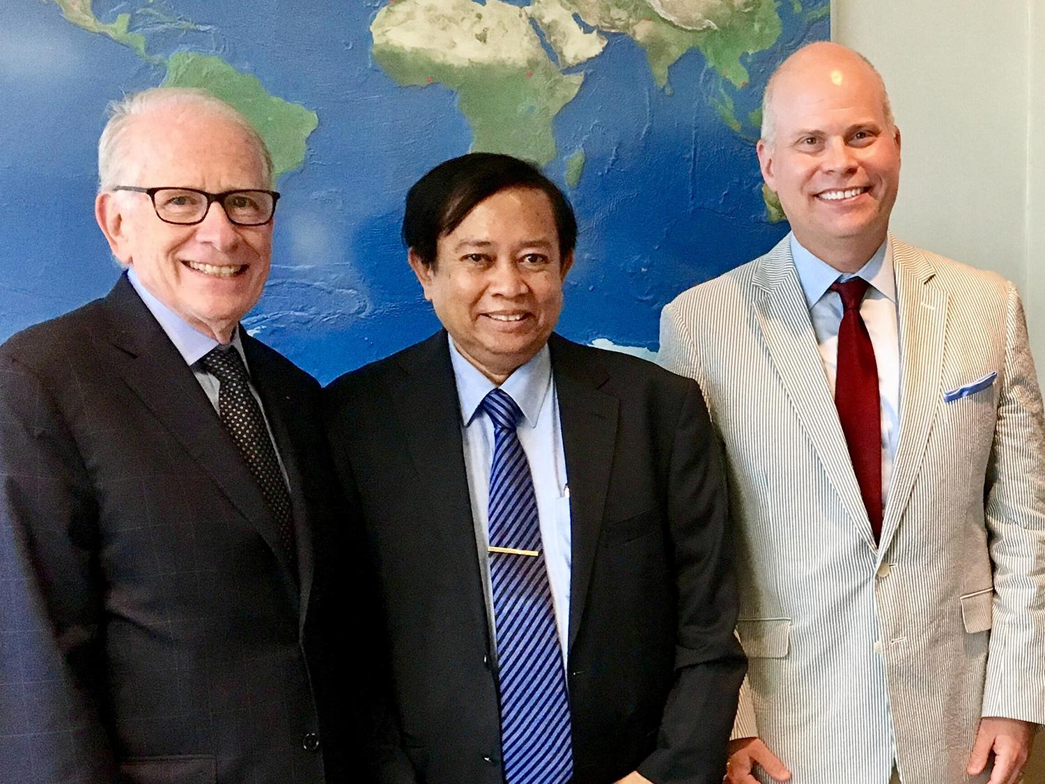 Allan Goodman (left), president of the Institute for International Education, meets in his New York City office with Joshua McKeown, director of international education and programs at SUNY Oswego, and Dr. Myint Oo, physician and educator from Myanmar