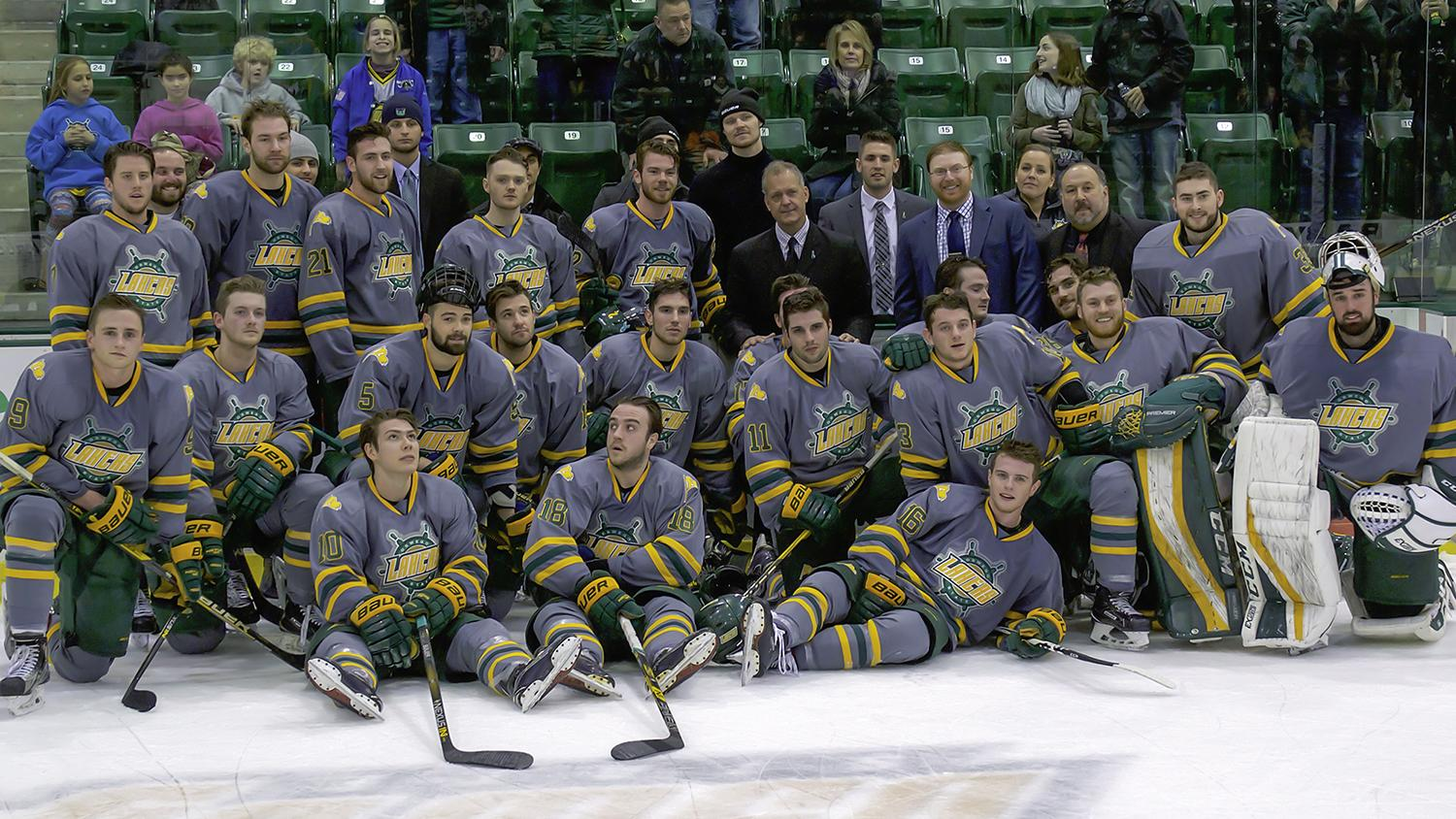 Hockey team, coaches celebrate Ed Gosek's 300th win