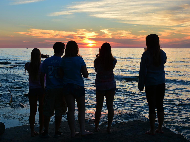 Students taking photos of Lake Ontario