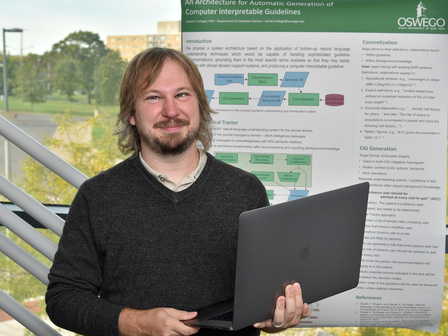 Daniel Schlegel with his research