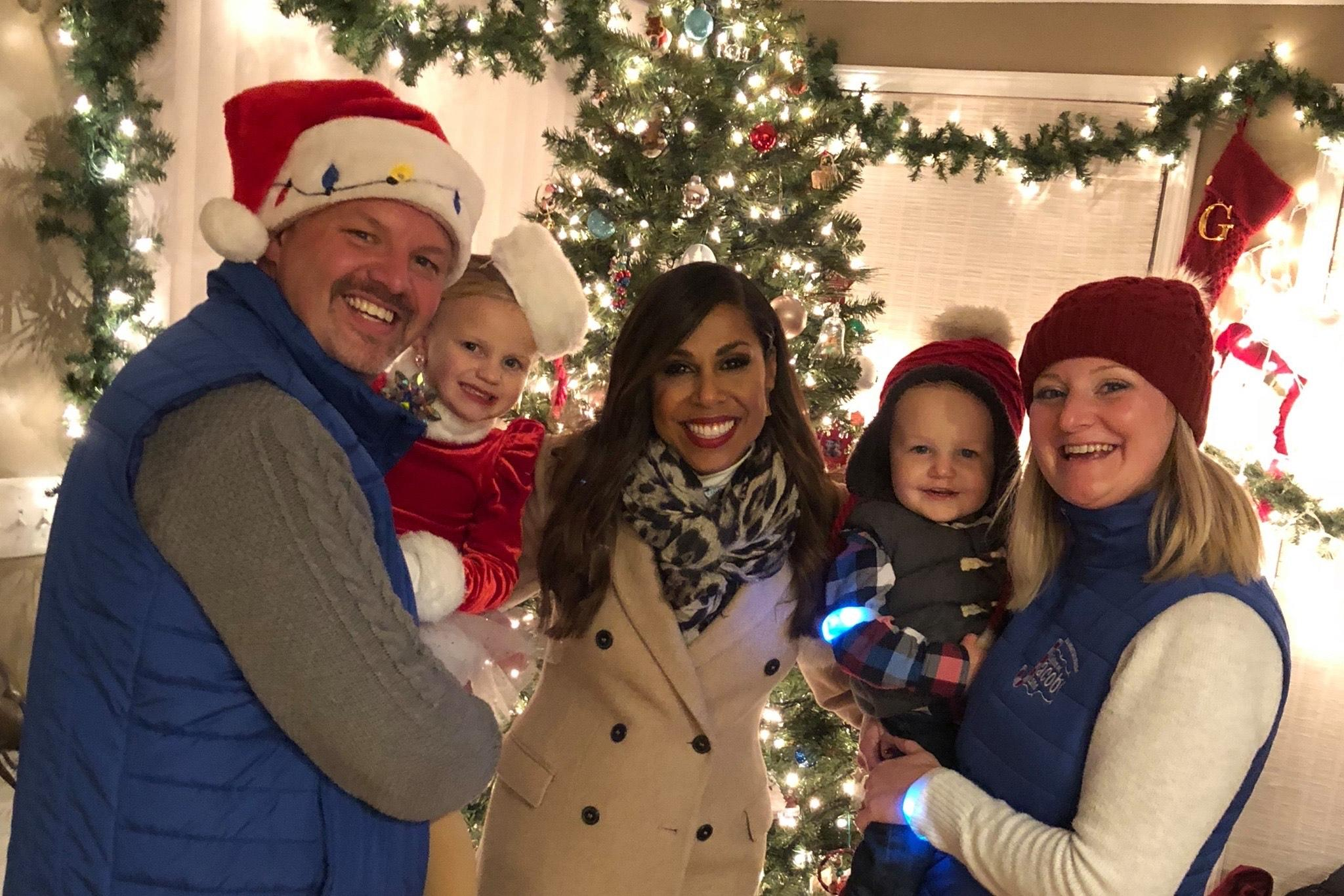 Brewster family with ABC Great Christmas Light Fight host Taniya Nayak (center)