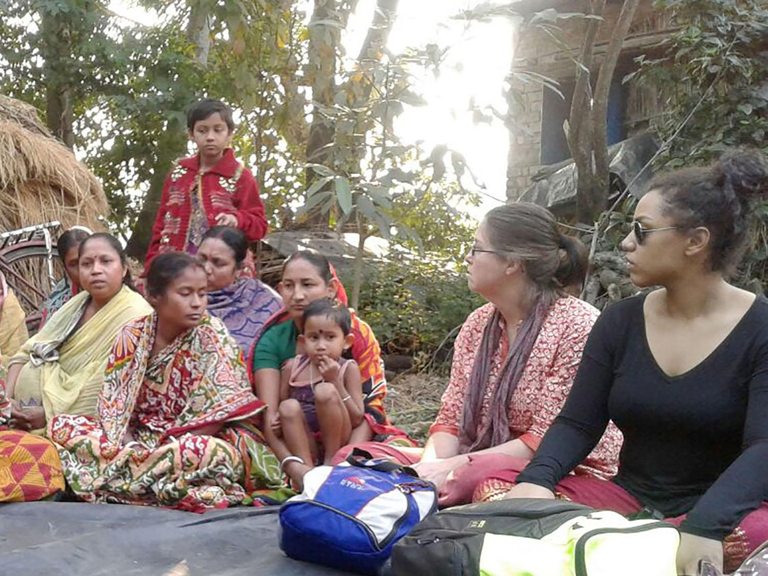 SUNY Oswego class members meeting with families in India