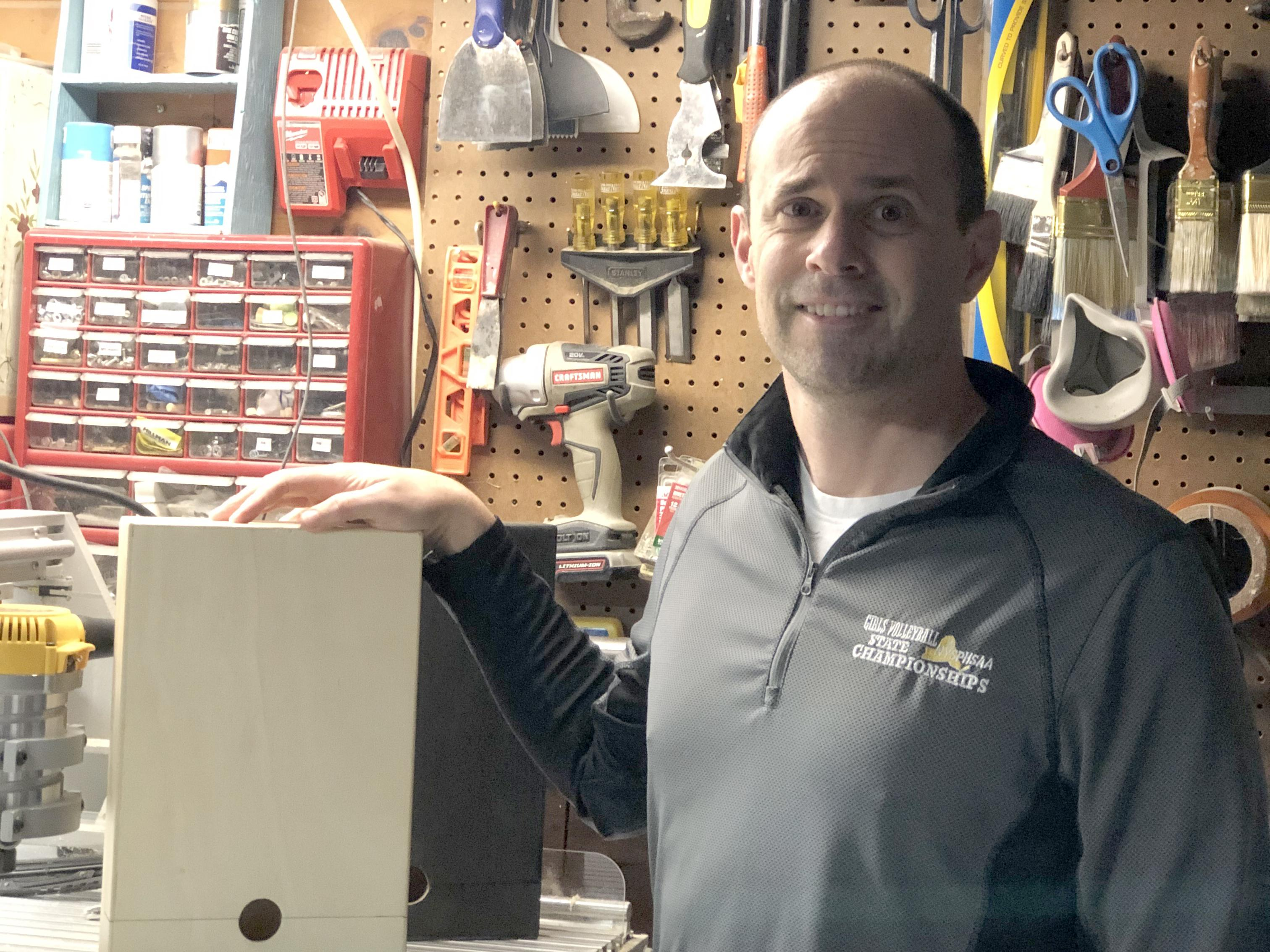 Jeff Evans, in his workshop space, shows off the wiNest, a patented idea that advanced to a statewide student business plan competition