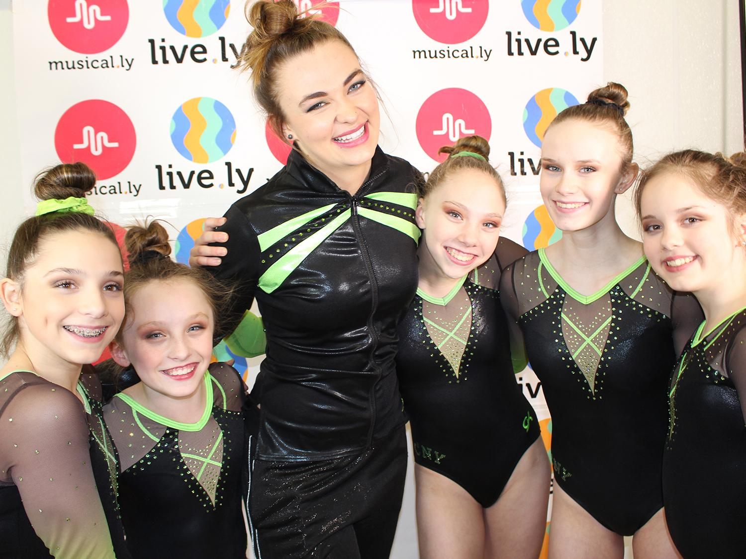 Joely Rice with gymnasts at photo shoot for her online show
