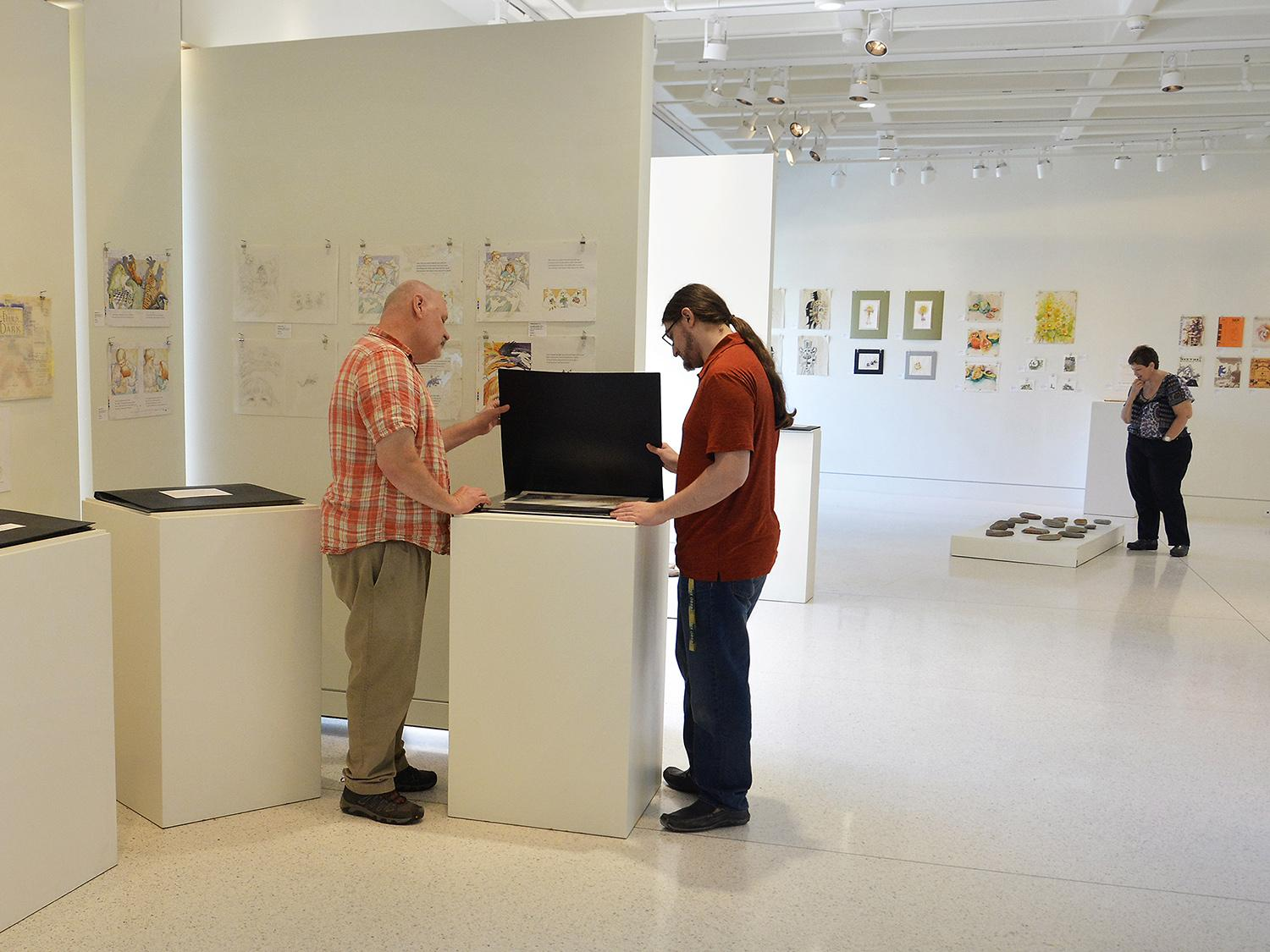Gallery workers prepare Judith Ann Benedict art exhibition