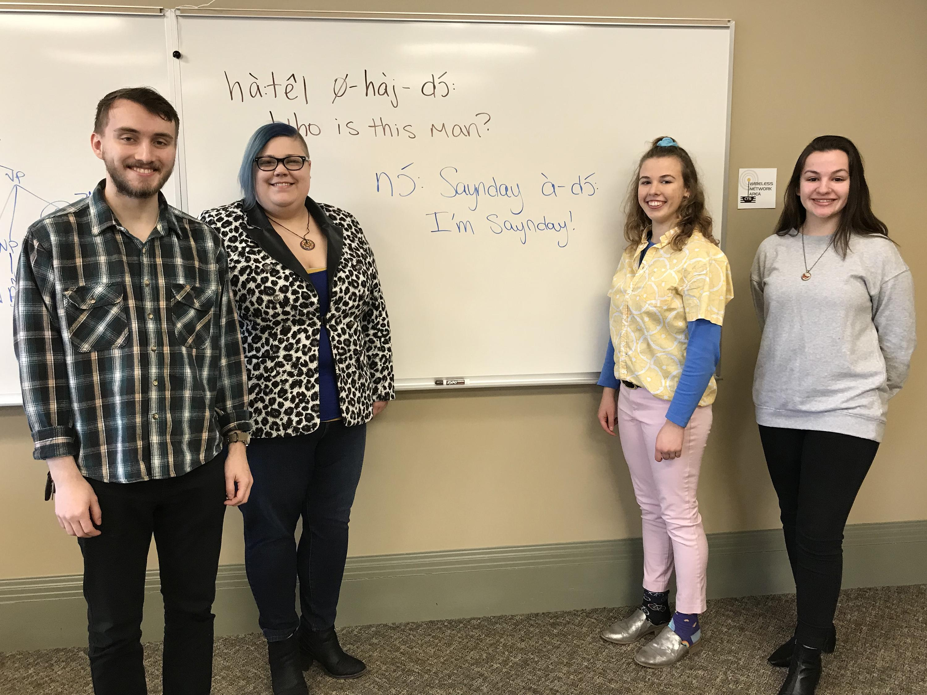 Faculty and students show off example of Kiowa language