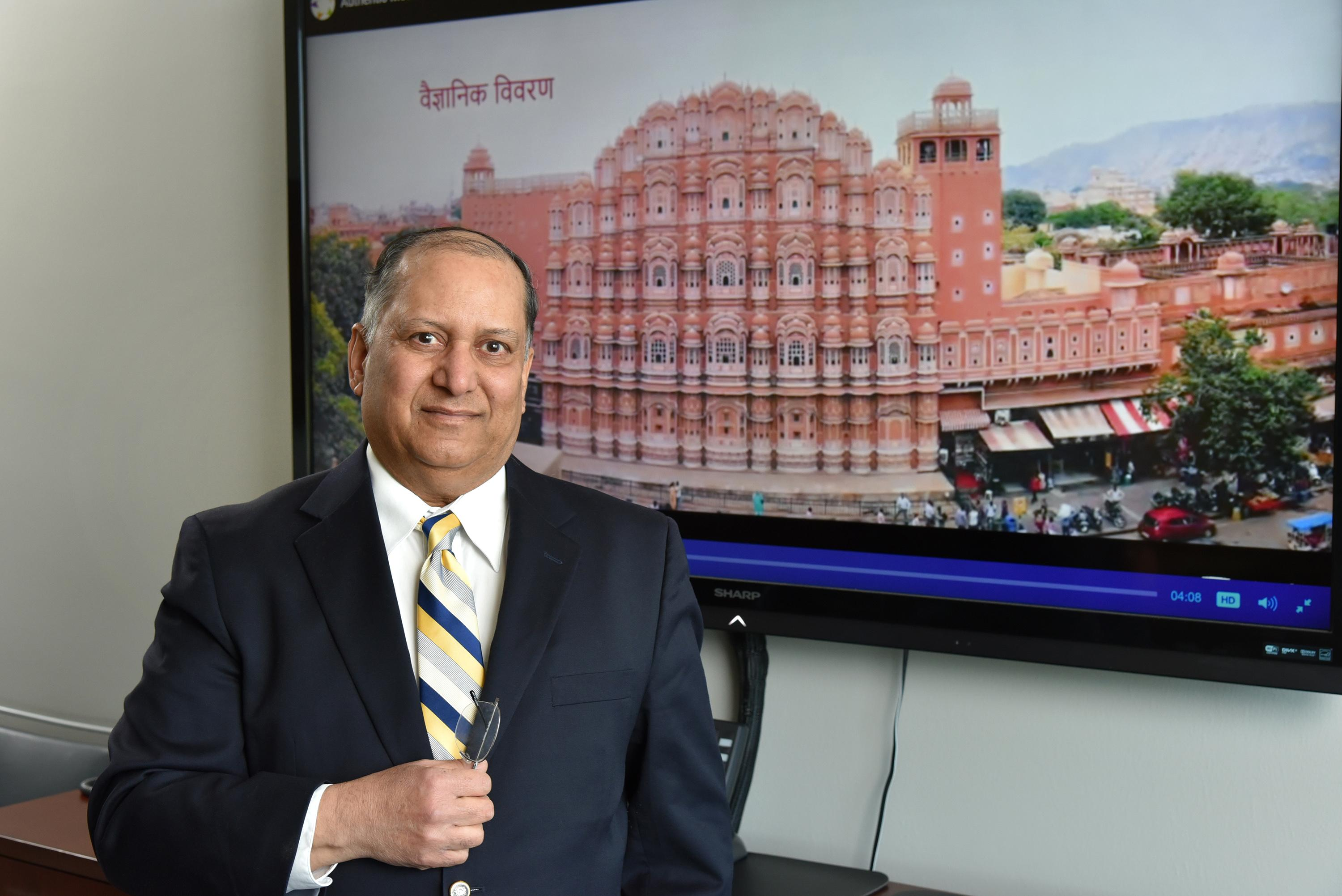 Alok Kumar with still of video he produced, this showing Hawa Mahal in Jaipur, a honeycomb structure built in 1799 that employs the Venturi effect for natural air conditioning