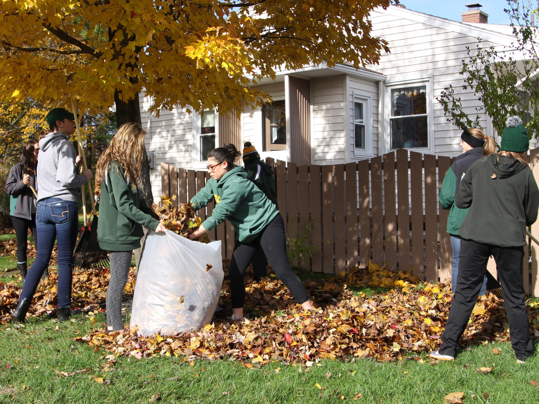 Laker student-athletes raking leaves