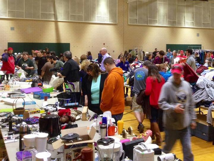 Shoppers browse for bargains on tables during Leave Green sale