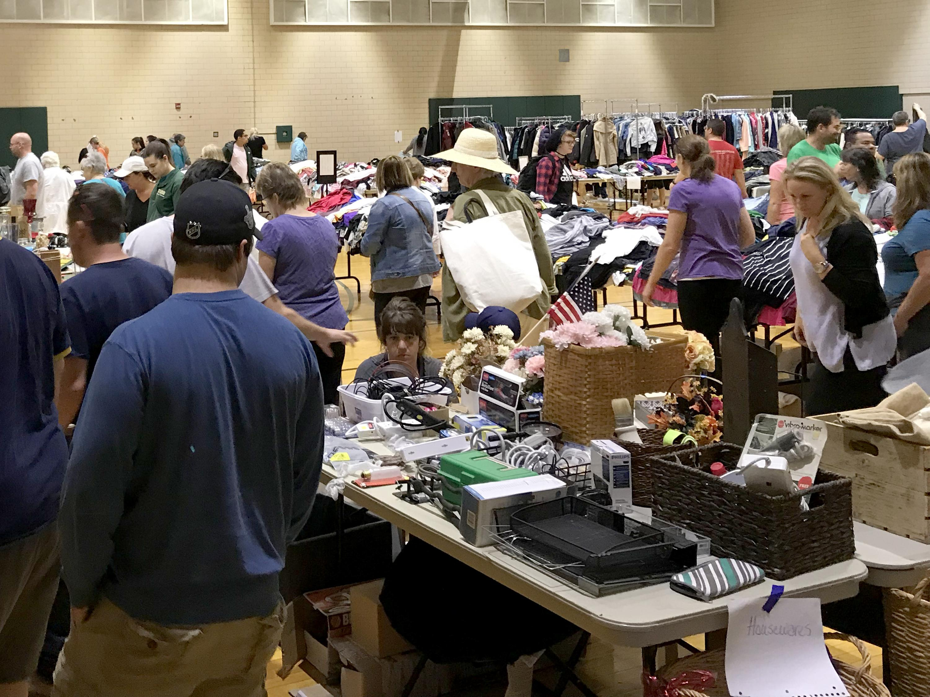Community members browse for bargains in Leave Green sale