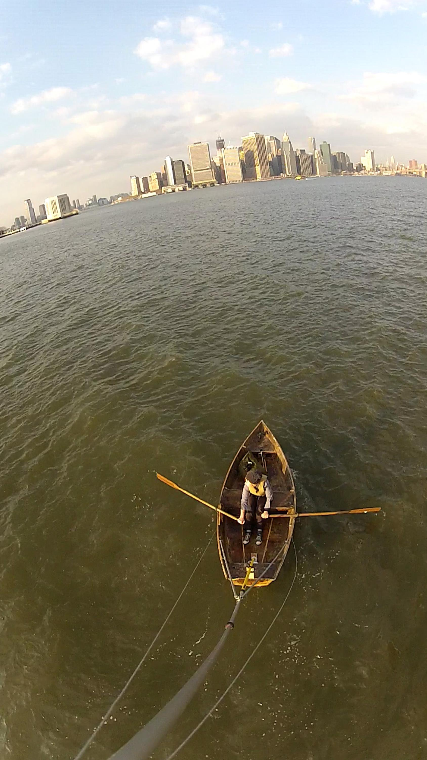 Photo of Marie Lorenz rowing a boat in New York City harbor
