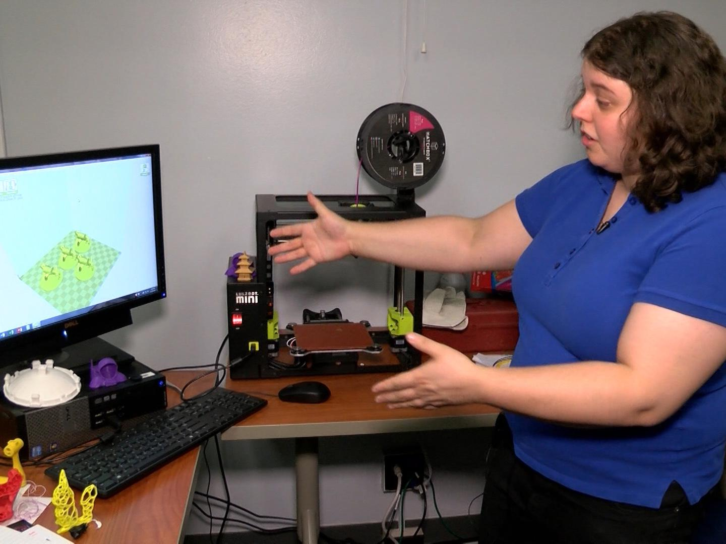 Sharona Ginsberg showing a 3D printer/computer station