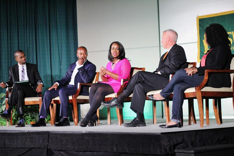 Media Summit panelists on stage during discussion