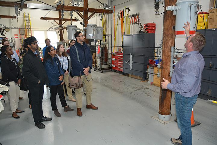 Matt Irland, National Grid overhead line instructor, talks to SUNY Oswego students about the rewards and risks of dealing with electric transmission lines