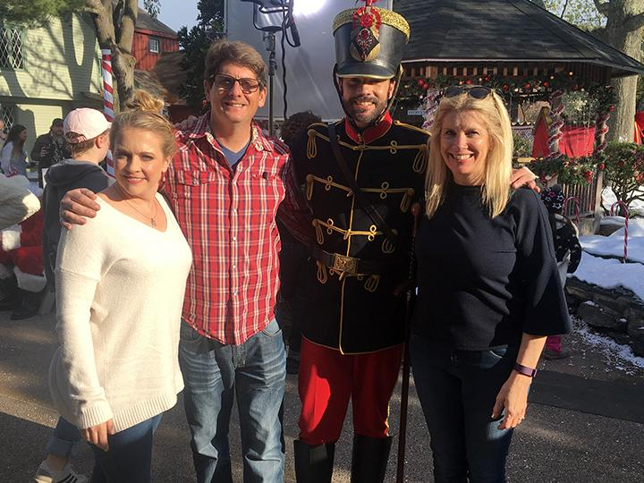 Faculty member Juliet Giglio poses with co-writing husband and stars from A Very Nutty Christmas