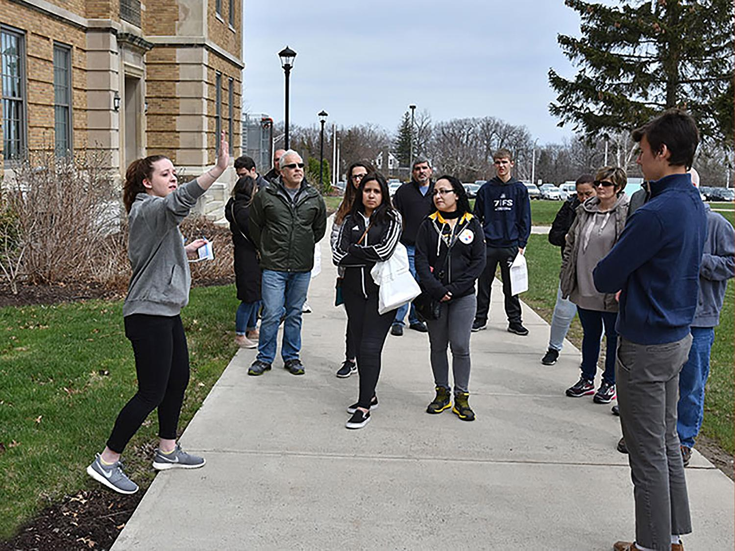 Student leads admission tour for families