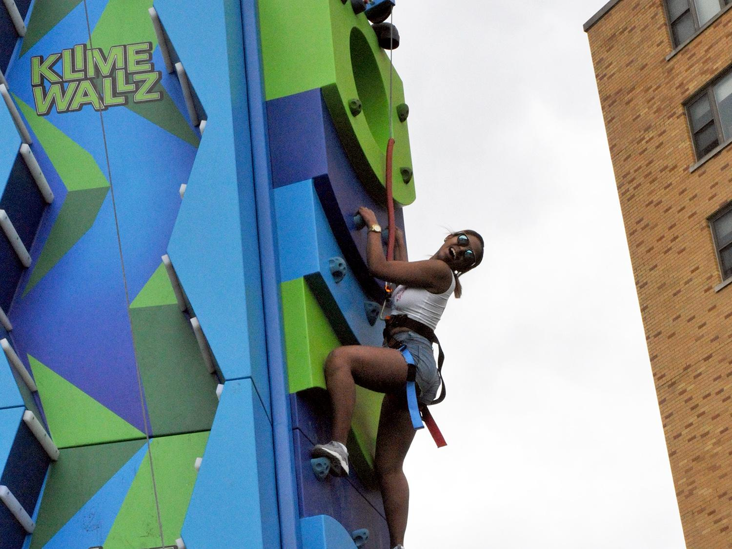 Student climbs an inflatable wall at OzFest