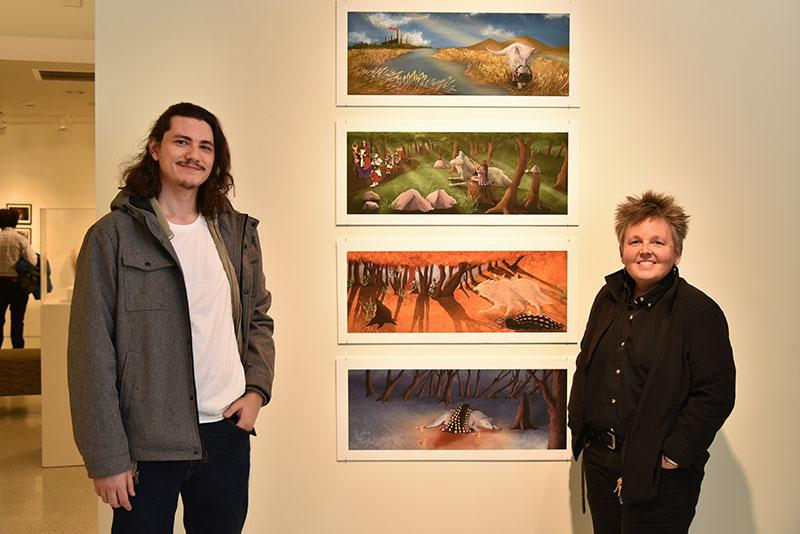 Student artist Arden McBride with faculty member Amy Bartell