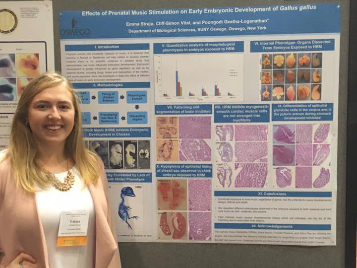 Emma Strujo with award-winning research poster