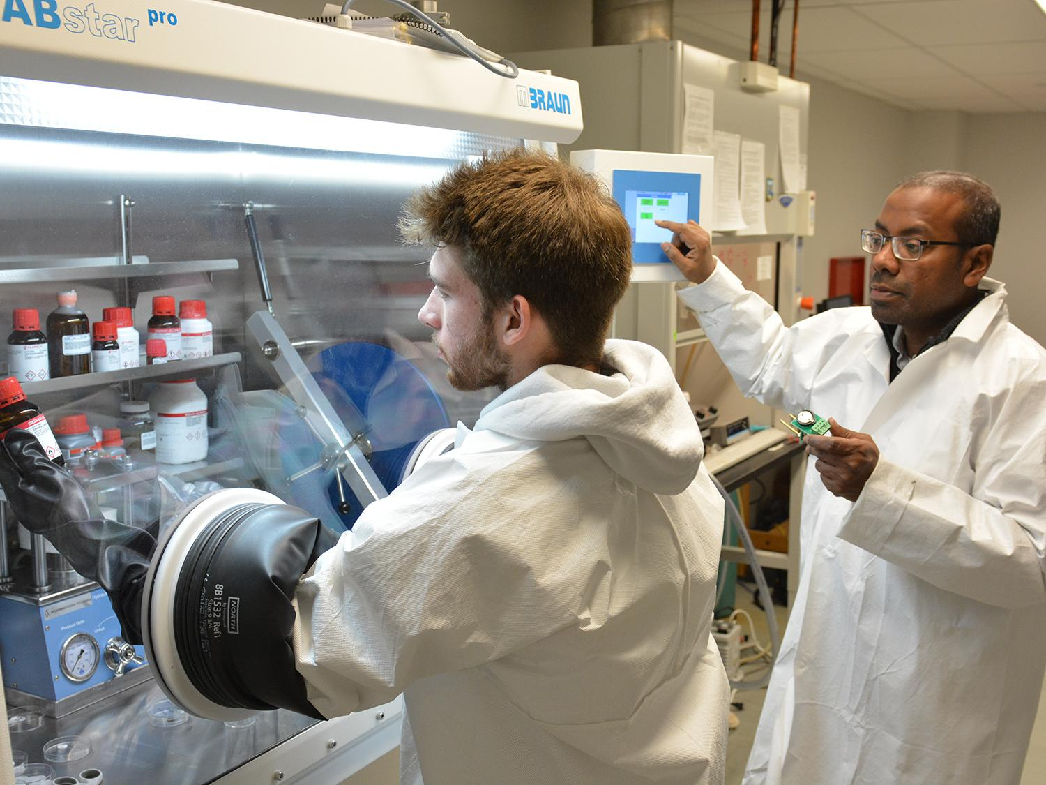 Student Josh Willson and faculty member Dr. Mohammad Islam work in a lab