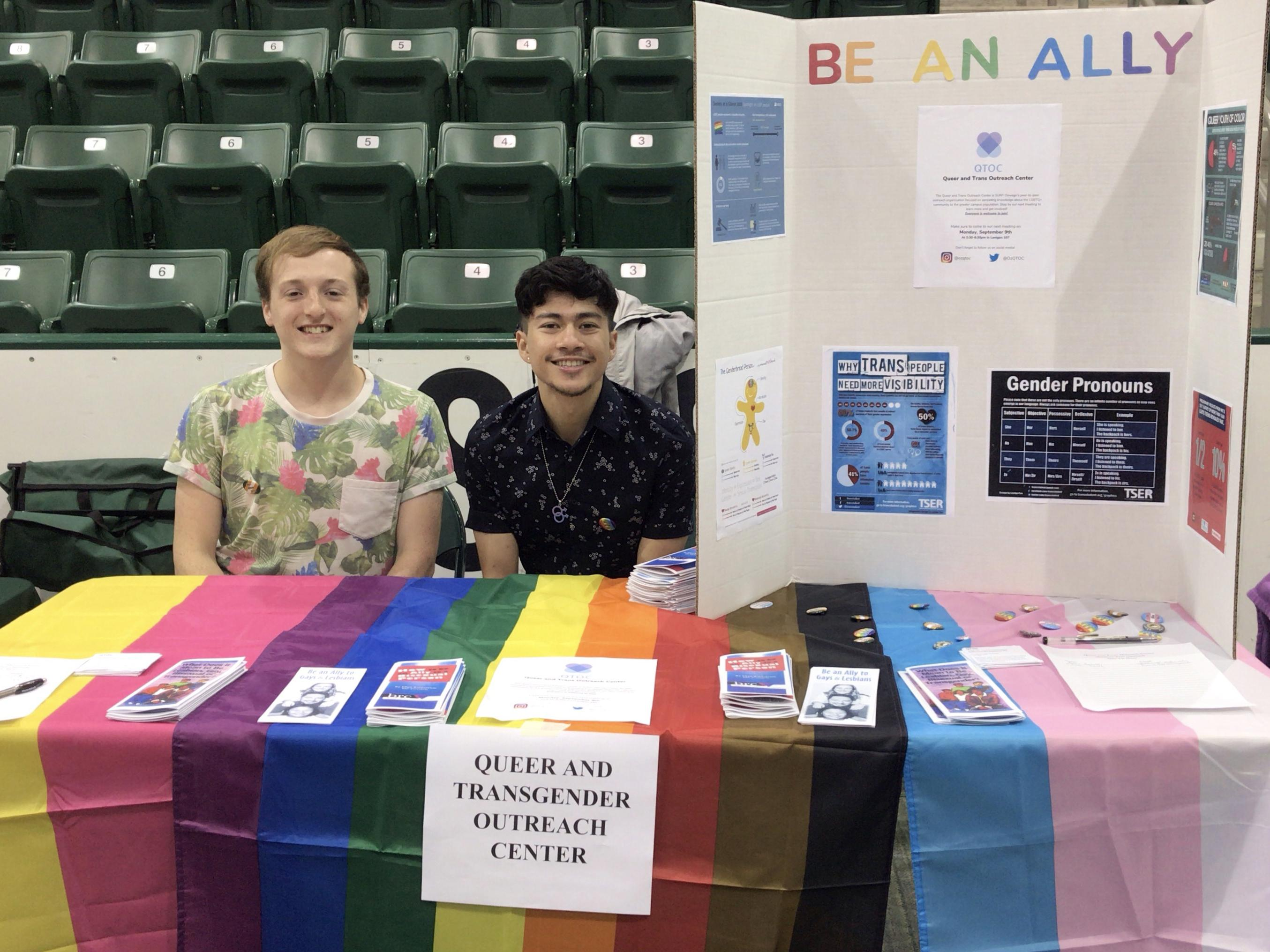 Students with the Queer and Trans Outreach Center participate in the Student Involvement Fair