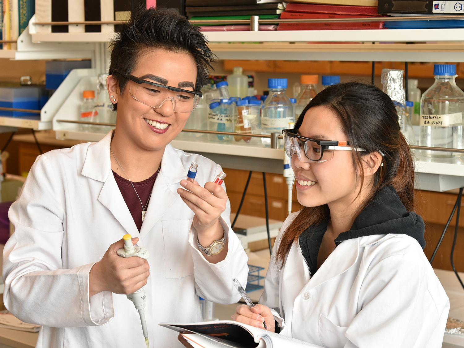Students in a biochemistry lab researching disease-stress relationship