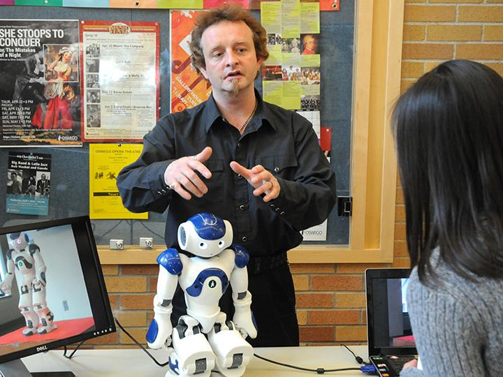 Damian Schofield with a robot