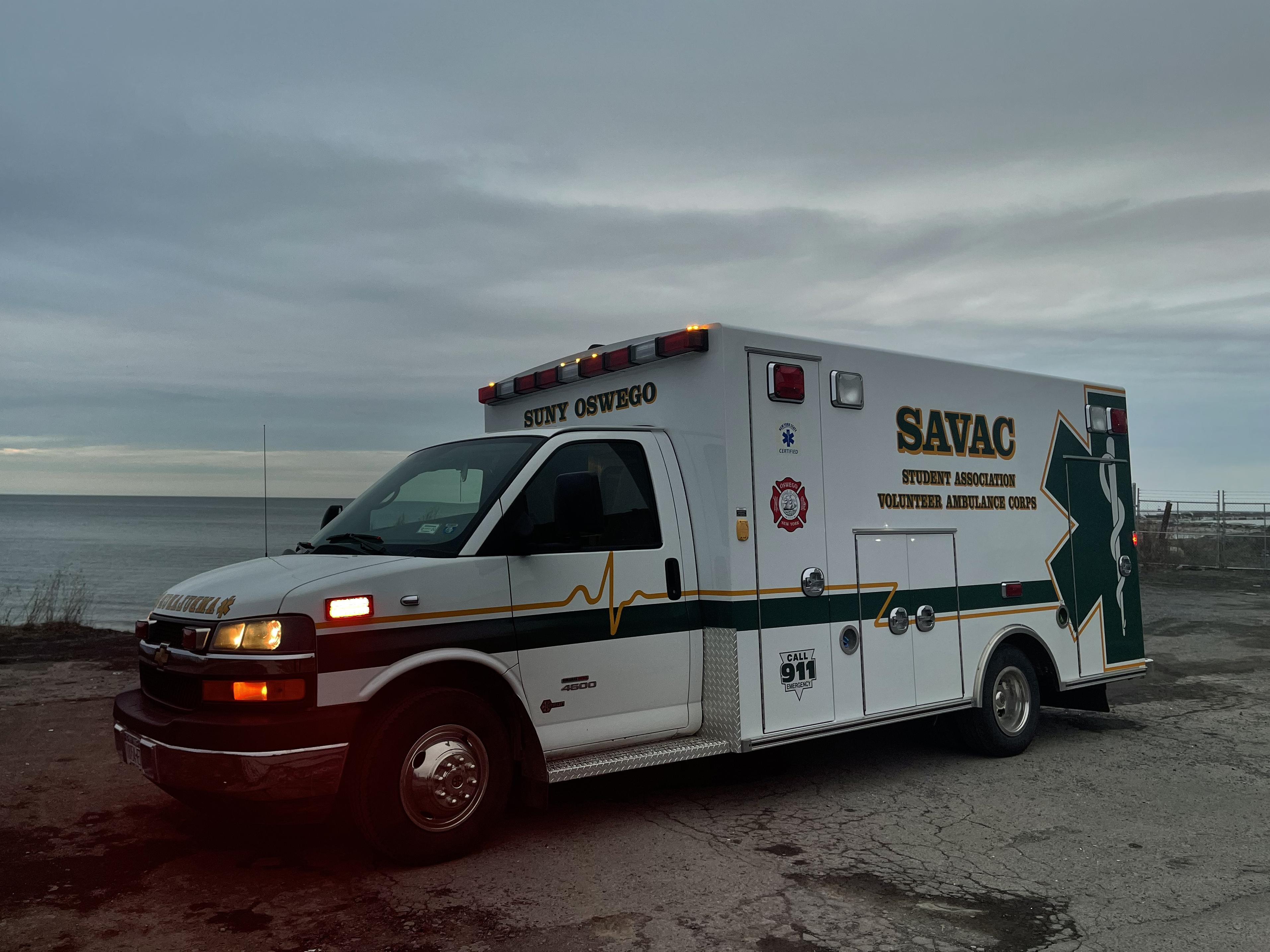 Photo of SAVAC ambulance on lakeshore at sunset