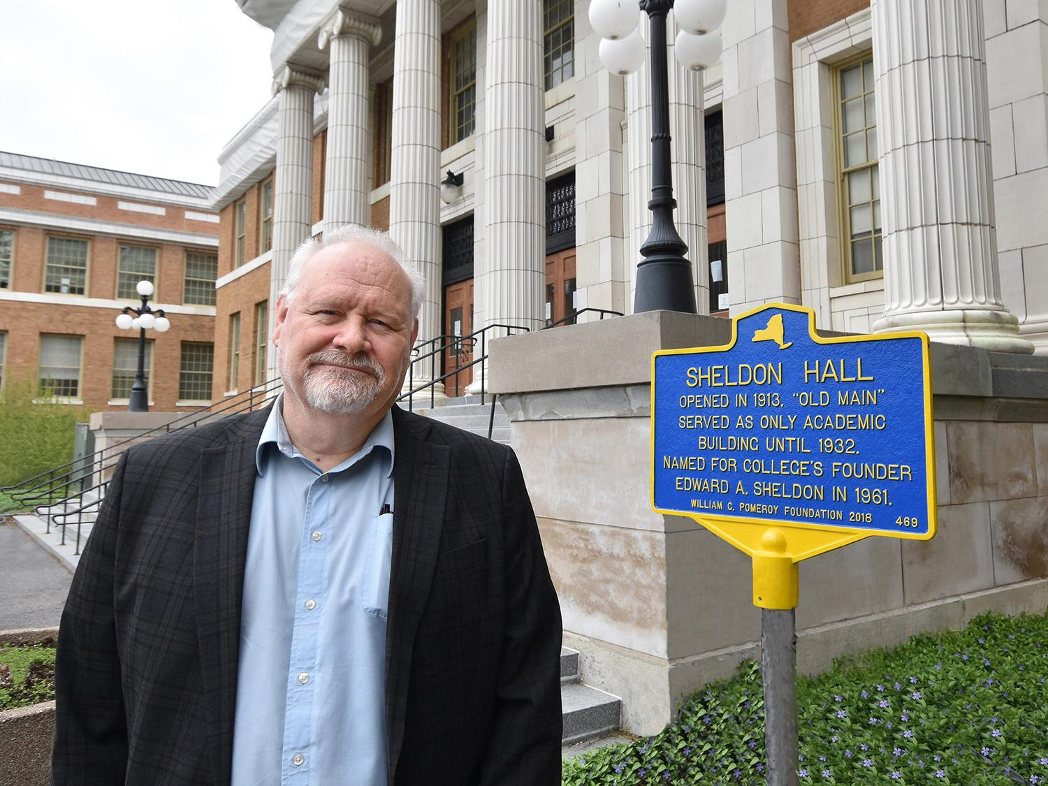 Tyler Art Gallery director Mike Flanagan with historic marker for Sheldon Hall