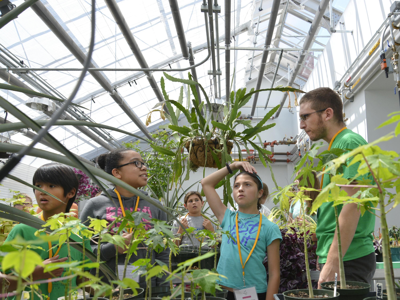 Children at the Sheldon Institute explore the greenhouse atop the Richard S. Shineman Center.