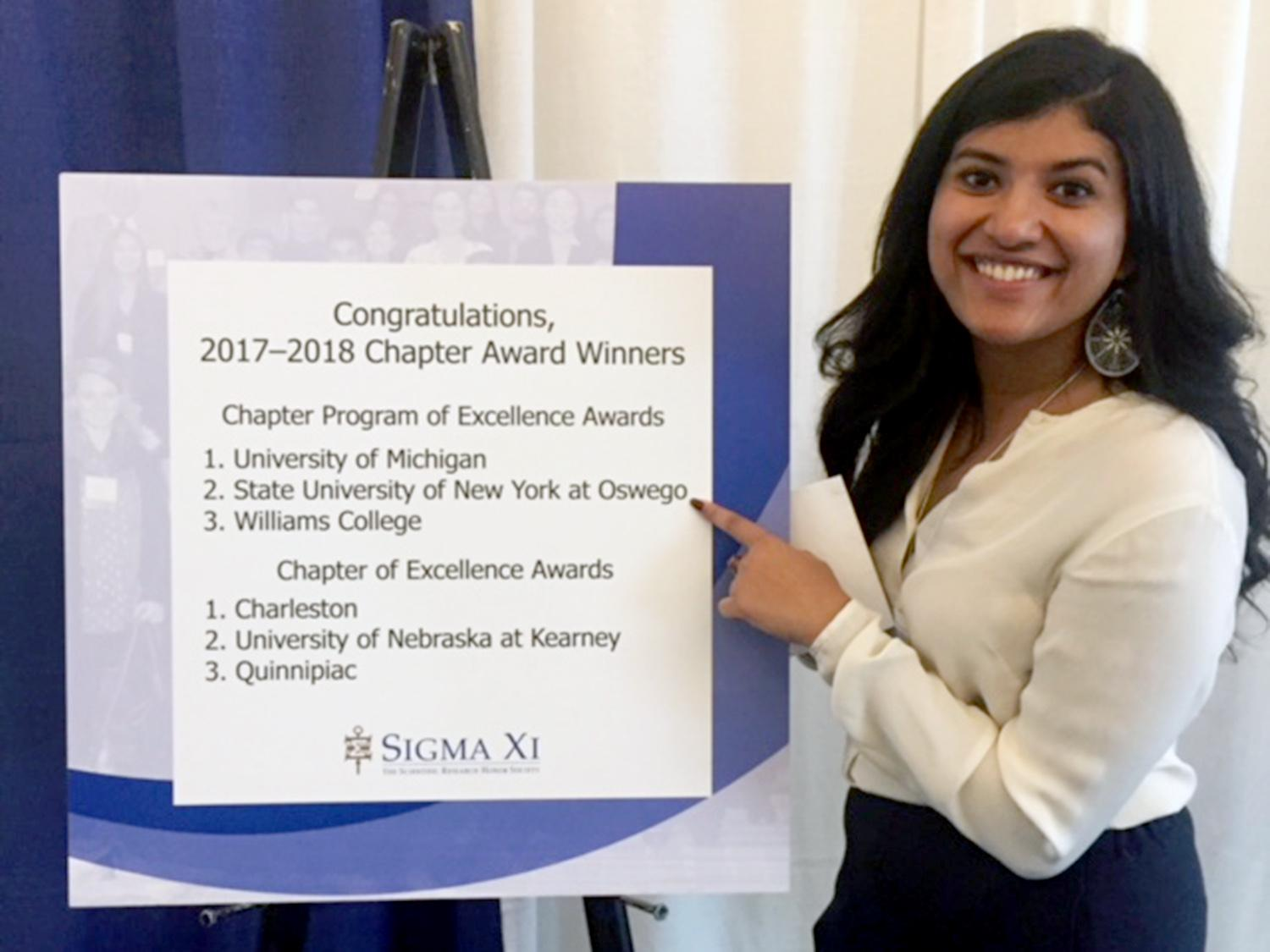 Manna Job shows pride in college's research accomplishments at Sigma Xi international conference