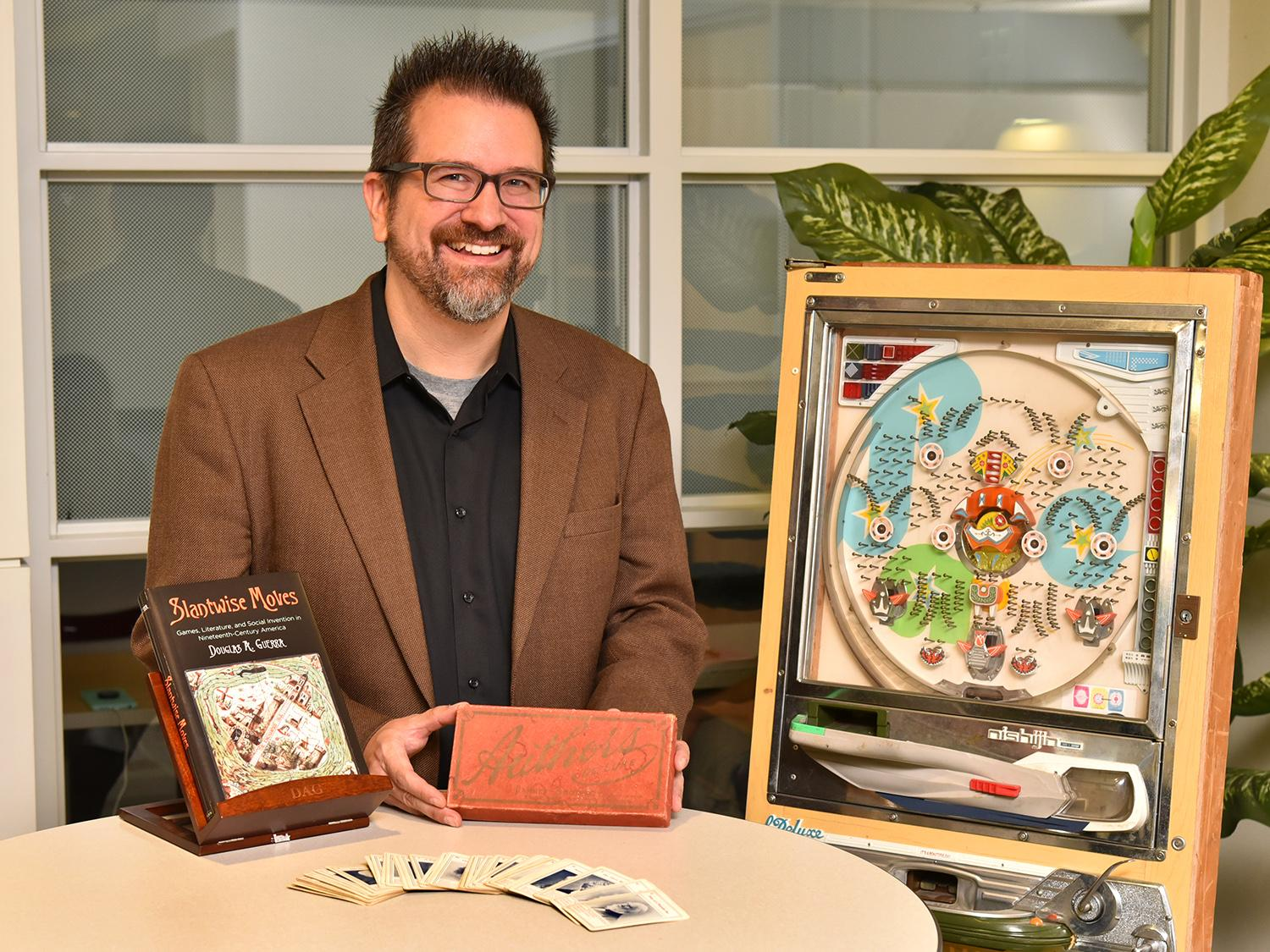 Douglas Guerra of SUNY Oswego's English and creative writing faculty recently earned the Popular Culture Association's Ray and Pat Browne Award for his book Slantwise Moves, which connects books, games and 19th-century social lives