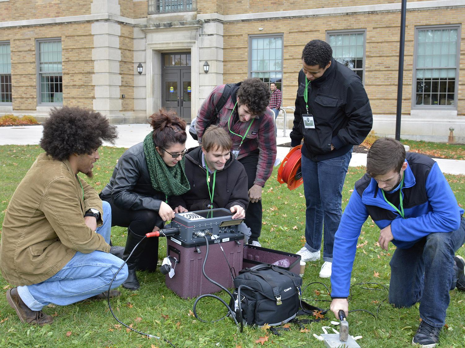 Students unpack a seismograph system