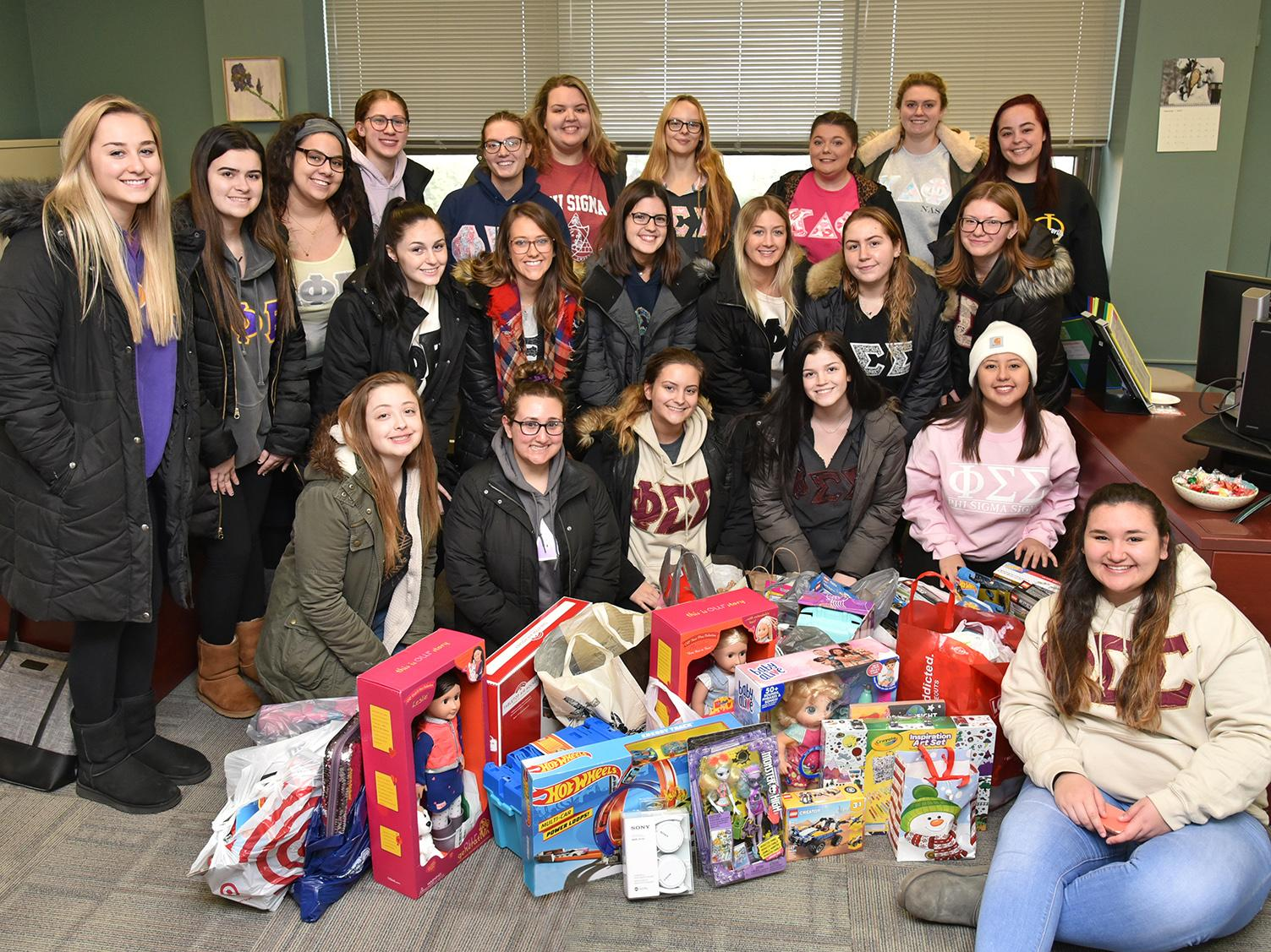 Sororities collected gifts and canned goods for the community