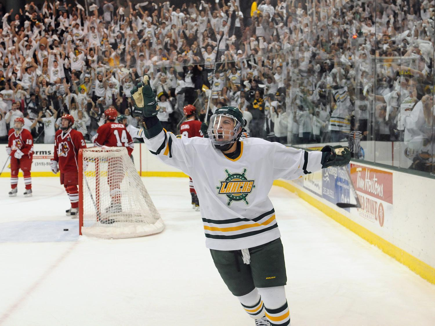 Laker hockey player celebrates along with Oswego fans