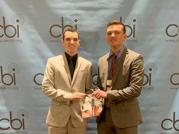 WNYO representatives Mark Rowlands and Ben Grimaudo accept first-place CBI award for Best Sports Play-By-Play